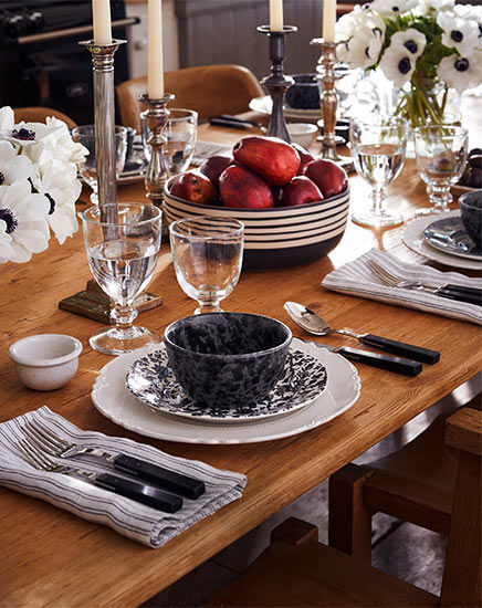 Table set with earthenware dishes in black & white patterns