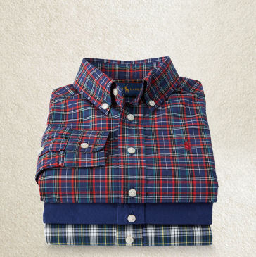 Stack of folded button-downs in plaids and solid blue