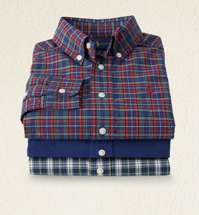 Stack of button-down shirts in red & blue plaid, solid blue & grey & green plaid