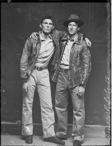 Old-timey photo of two jacket-clad men