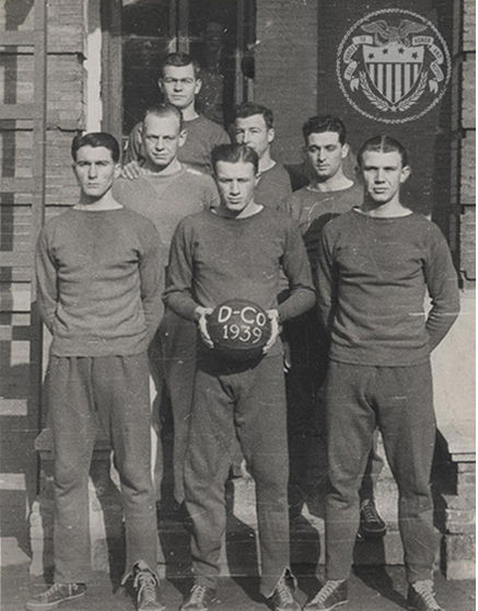 Old-timey photo of men in sports training apparel